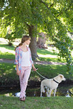 Cute blonde with her labrador dog in the park