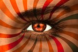 Orange eye on patterned face