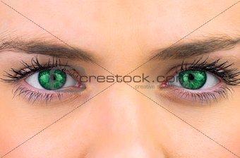 Bright green eyes on pretty female face