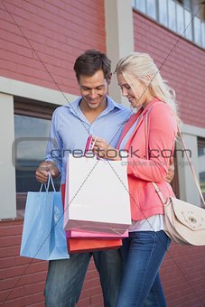 Stylish young couple on a shopping trip