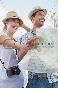 Young tourist couple using the map