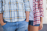 Young hip couple wearing check shirts and denim