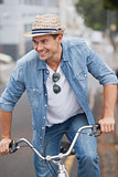 Hip young man in denim on his bike