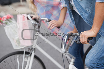Hip young couple on their bikes