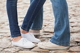 Couple in jeans standing on path