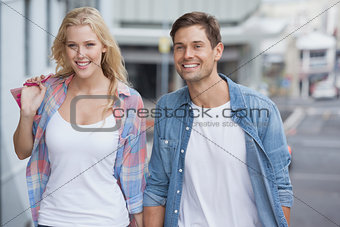 Cute young couple walking with shopping bags