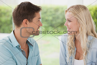 Cute young couple smiling at each other