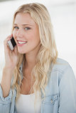 Cute blonde talking on phone