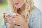 Cute blonde holding white mug