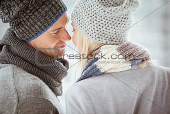 Couple in warm clothing facing each other