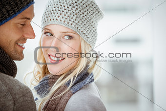 Couple in warm clothing hugging