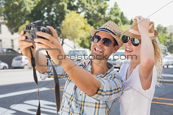 Young hip couple taking a selfie