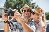 Hip young couple taking a selfie with camera