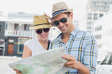 Young tourist couple consulting the map