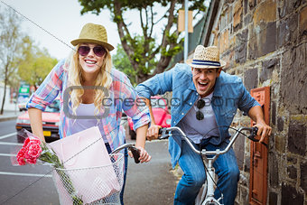 Hip young couple on a bike ride