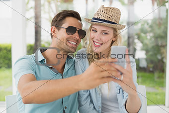 Hip young couple taking a selfie together