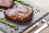 Beef steaks with rosemary and spices