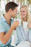 Hip young couple having coffee together