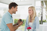 Man proposing marriage to his blonde girlfriend