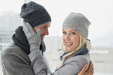 Cute couple in warm clothing hugging