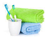Two colorful toothbrushes and towels