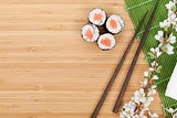 Sushi set, chopsticks and sakura branch