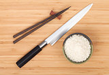 Rice bowl, chopsticks and sushi knife