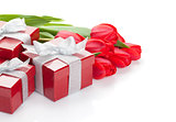 Fresh red tulips with gift boxes
