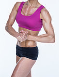 Female bodybuilder posing with hands together