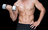 Muscular man lifting heavy dumbbell
