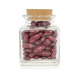 Bottle full of Kidney  beans white background
