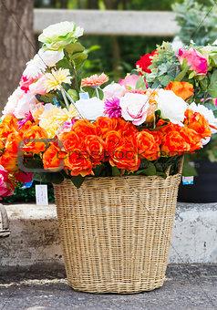 Fake fabric roses in basket