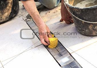 Floor tiler at work 5