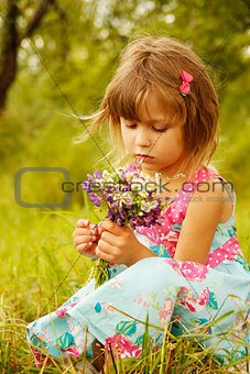 beautiful little girl on nature