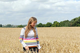 Happy, laughing girl in a field laughing on a sunny day