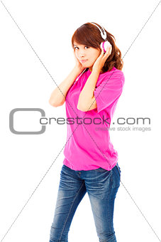 Portrait of cute young woman listening to music with headphones