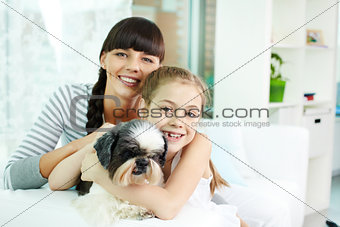 Mother, daughter and pet