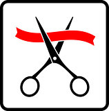 red ribbon and cutting scissors