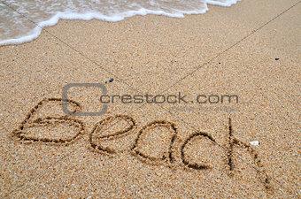 Beach word written on the sandy beach
