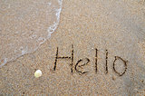 Hello word written on the sandy beach