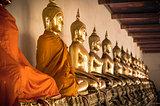 Buddha statues ina  row at Wat Arun in Bangkok, Thailand.