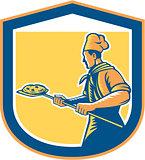 Baker Pizza Maker Holding Peel Pizza Shield