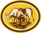 Farmer Milking Cow Oval Woodcut