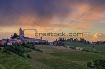 Small town on the hill under cloudy sky in Italy