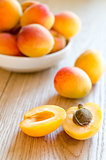 Fresh apricots on the wooden table