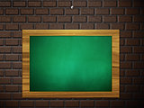 Green chalkboard hang on brick wall