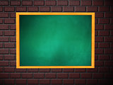 Chalkboard of green color on brick wall