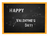 Happy valentine's day phrase on blackboard