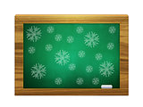 Snowflakes on green board