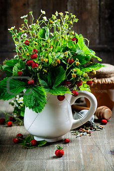 bouquet of wild strawberry with herbal tea and honey